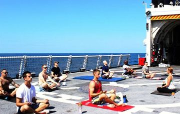 US Coast Guard Crew Finds Their Balance with Flight Deck Yoga