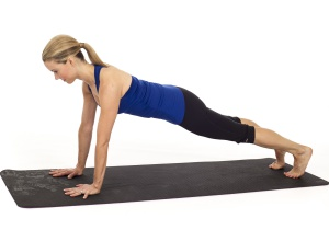 Woman on a yoga mat doing Plank