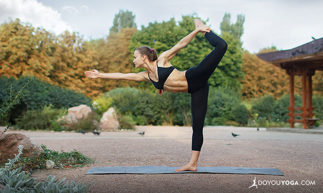 Woman striking yoga pose