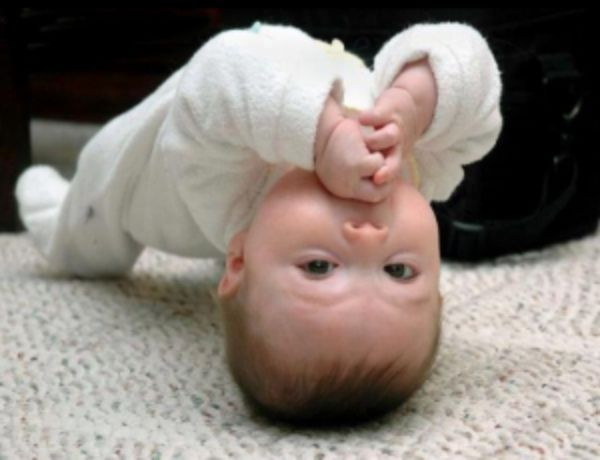 12 Adorable Babies Doing Yoga -- fish pose