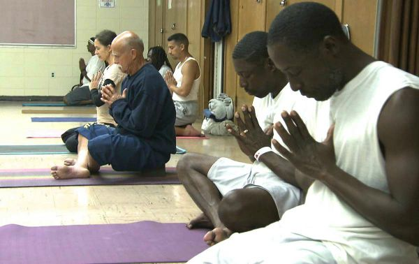 Prisoners participating in a yoga class at San Quentin Source: Sutra Journal