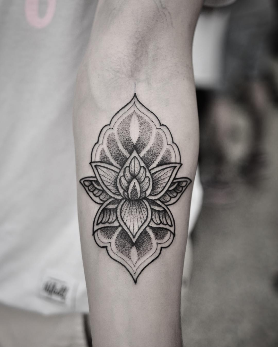dotwork lotus tattoo on forearm
